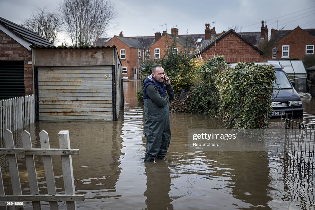 Matt Beesley stands in his flooded driveway on Diglis Avenue on February 12 2014 in Worcester England The Environment Agency has issued flood...