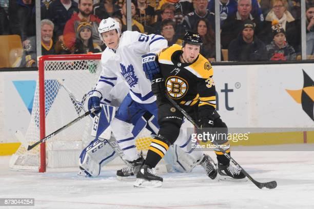 Matt Beleksey of the Boston Bruins against Jake Gardiner of the Toronto Maple Leafs at the TD Garden on November 11 2017 in Boston Massachusetts