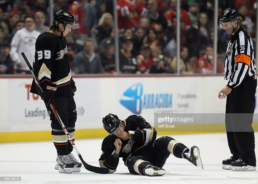 <a gi-track='captionPersonalityLinkClicked' href=/galleries/search?phrase=Matt+Beleskey&family=editorial&specificpeople=570471 ng-click='$event.stopPropagation()'>Matt Beleskey</a> (L) #39 of the Anaheim Ducks and referee Dean Morton (R) look down at <a gi-track='captionPersonalityLinkClicked' href=/galleries/search?phrase=Andrew+Cogliano&family=editorial&specificpeople=869296 ng-click='$event.stopPropagation()'>Andrew Cogliano</a> #7 of the Ducks, as he holds his mouth after being high sticked in the third period at Honda Center on March 20, 2013 in Anaheim, California. The Ducks defeated the Blackhawks 4-2.