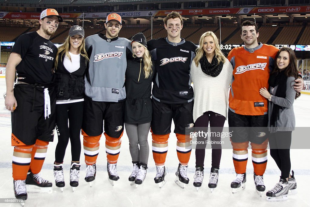 <a gi-track='captionPersonalityLinkClicked' href=/galleries/search?phrase=Matt+Beleskey&family=editorial&specificpeople=570471 ng-click='$event.stopPropagation()'>Matt Beleskey</a> #39, <a gi-track='captionPersonalityLinkClicked' href=/galleries/search?phrase=Nick+Bonino&family=editorial&specificpeople=5805660 ng-click='$event.stopPropagation()'>Nick Bonino</a> #13, <a gi-track='captionPersonalityLinkClicked' href=/galleries/search?phrase=Cam+Fowler&family=editorial&specificpeople=5484080 ng-click='$event.stopPropagation()'>Cam Fowler</a> #4 and <a gi-track='captionPersonalityLinkClicked' href=/galleries/search?phrase=Kyle+Palmieri&family=editorial&specificpeople=4783296 ng-click='$event.stopPropagation()'>Kyle Palmieri</a> #21 of the Anaheim Ducks pose for a group photo with their girlfriends after team practice in preparation for the 2014 Coors Light NHL Stadium Series against the Los Angeles Kings at Dodger Stadium on January 24, 2014 in Los Angeles, California.