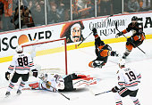 Matt Beleskey of the Anaheim Ducks celebrates scoring the game winning overtime goal as he trips over goaltender Corey Crawford of the Chicago...