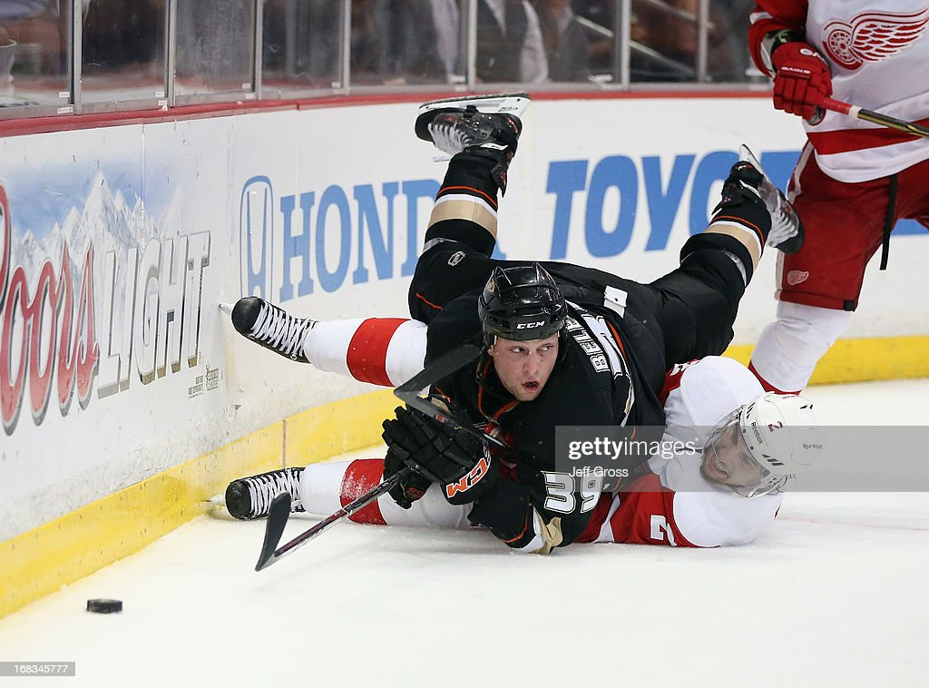 Matt Beleskey #39 of the Anaheim Ducks falls over Brednan Smith #2 of the Detroit Red Wings in the third period in Game Five of the Western Conference Quarterfinals during the 2013 NHL Stanley Cup Playoffs at Honda Center on May 8, 2013 in Anaheim, California.