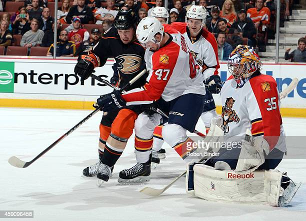 Matt Beleskey of the Anaheim Ducks fights for position against Colby Robak of the Florida Panthers with goalie Al Montoya defending against a shot on...