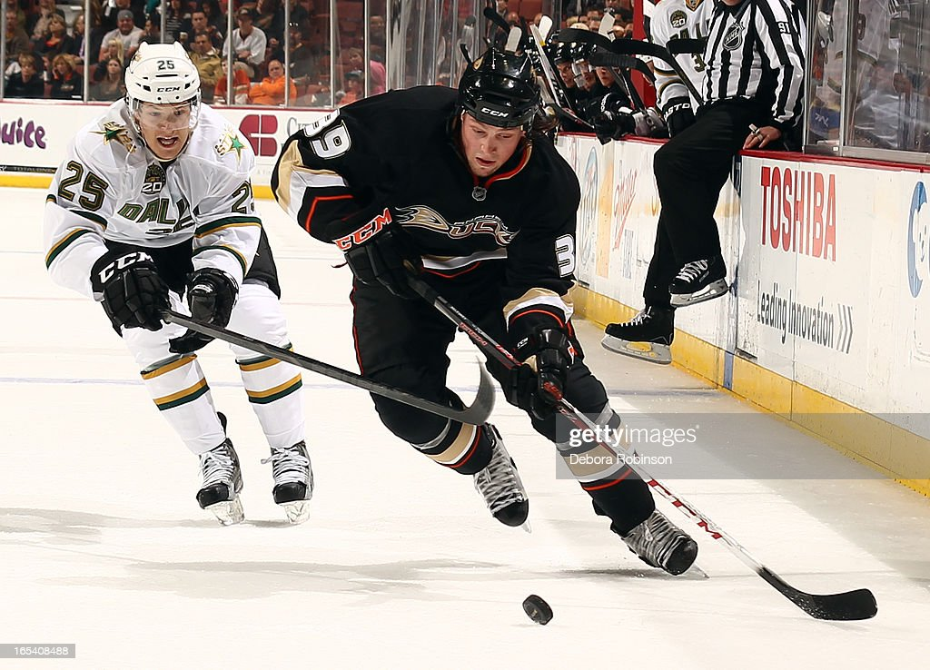 <a gi-track='captionPersonalityLinkClicked' href=/galleries/search?phrase=Matt+Beleskey&family=editorial&specificpeople=570471 ng-click='$event.stopPropagation()'>Matt Beleskey</a> #39 of the Anaheim Ducks handles the puck against Matt Fraser #25 of the Dallas Stars on April 3, 2013 at Honda Center in Anaheim, California.