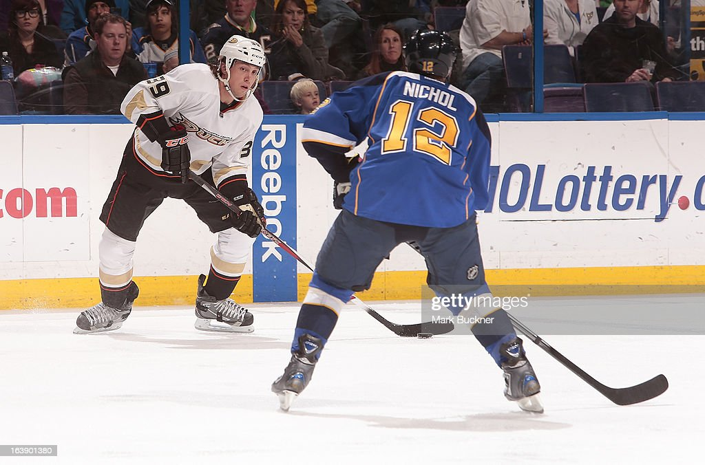 Matt Beleskey of the Anaheim Ducks handles the puck as Scott Nichol of the St Louis Blues defends in an NHL game on March 16 2013 at Scottrade Center...