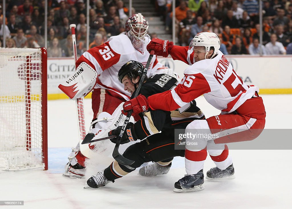 <a gi-track='captionPersonalityLinkClicked' href=/galleries/search?phrase=Matt+Beleskey&family=editorial&specificpeople=570471 ng-click='$event.stopPropagation()'>Matt Beleskey</a> #39 of the Anaheim Ducks is checked by <a gi-track='captionPersonalityLinkClicked' href=/galleries/search?phrase=Niklas+Kronwall&family=editorial&specificpeople=220826 ng-click='$event.stopPropagation()'>Niklas Kronwall</a> #55 of the Detroit Red Wings in the first period of Game Five of the Western Conference Quarterfinals during the 2013 NHL Stanley Cup Playoffs at Honda Center on May 8, 2013 in Anaheim, California. The Ducks defeated the Red Wings 3-2 in overtime.