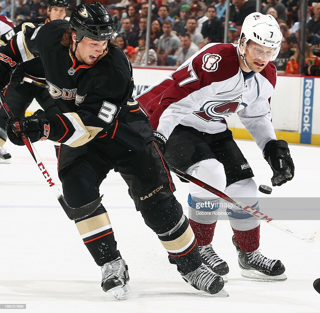 Matt Beleskey #39 of the Anaheim Ducks moves the puck past John Mitchell #7 of the Colorado Avalanche April 10, 2013 at Honda Center in Anaheim, California.