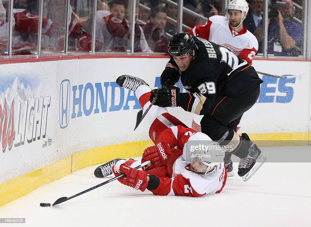 Matt Beleskey #39 of the Anaheim Ducks pursues Brednan Smith #2 of the Detroit Red Wings for the puck in the third period in Game Five of the Western Conference Quarterfinals during the 2013 NHL Stanley Cup Playoffs at Honda Center on May 8, 2013 in Anaheim, California.