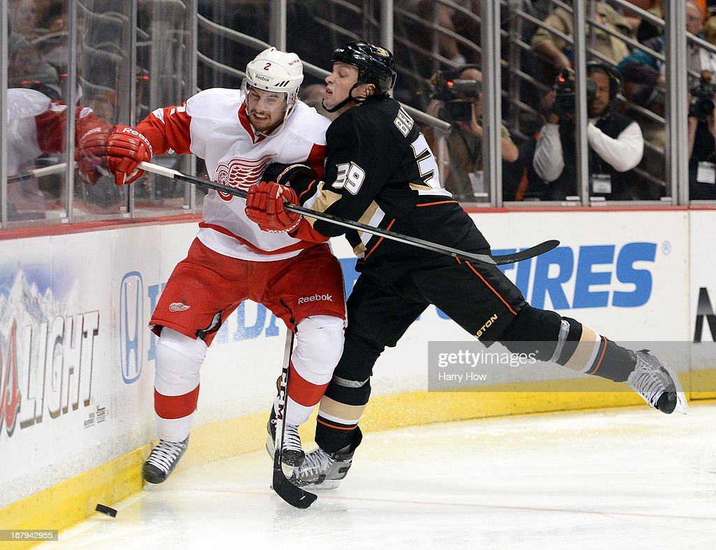<a gi-track='captionPersonalityLinkClicked' href=/galleries/search?phrase=Matt+Beleskey&family=editorial&specificpeople=570471 ng-click='$event.stopPropagation()'>Matt Beleskey</a> #39 of the Anaheim Ducks puts a hit on Brendan Smith #2 of the Detroit Red Wings during the third period in Game Two of the Western Conference Quarterfinals during the 2013 Stanley Cup Playoffs at Honda Center on May 2, 2013 in Anaheim, California. The Red Wings won 5-4 in overtime.