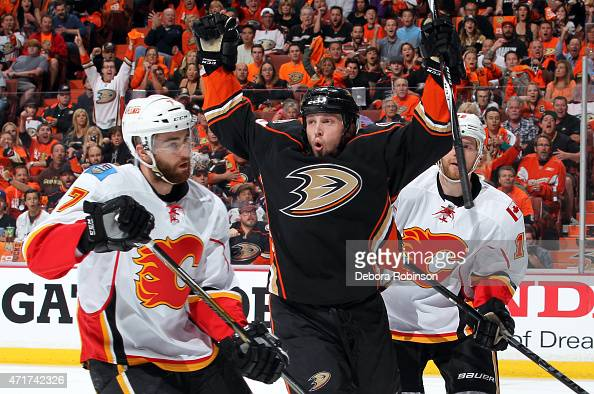 Matt Beleskey of the Anaheim Ducks reacts after scoring against TJ Brodie and Matt Stajan of the Calgary Flames in Game One of the Western Conference...