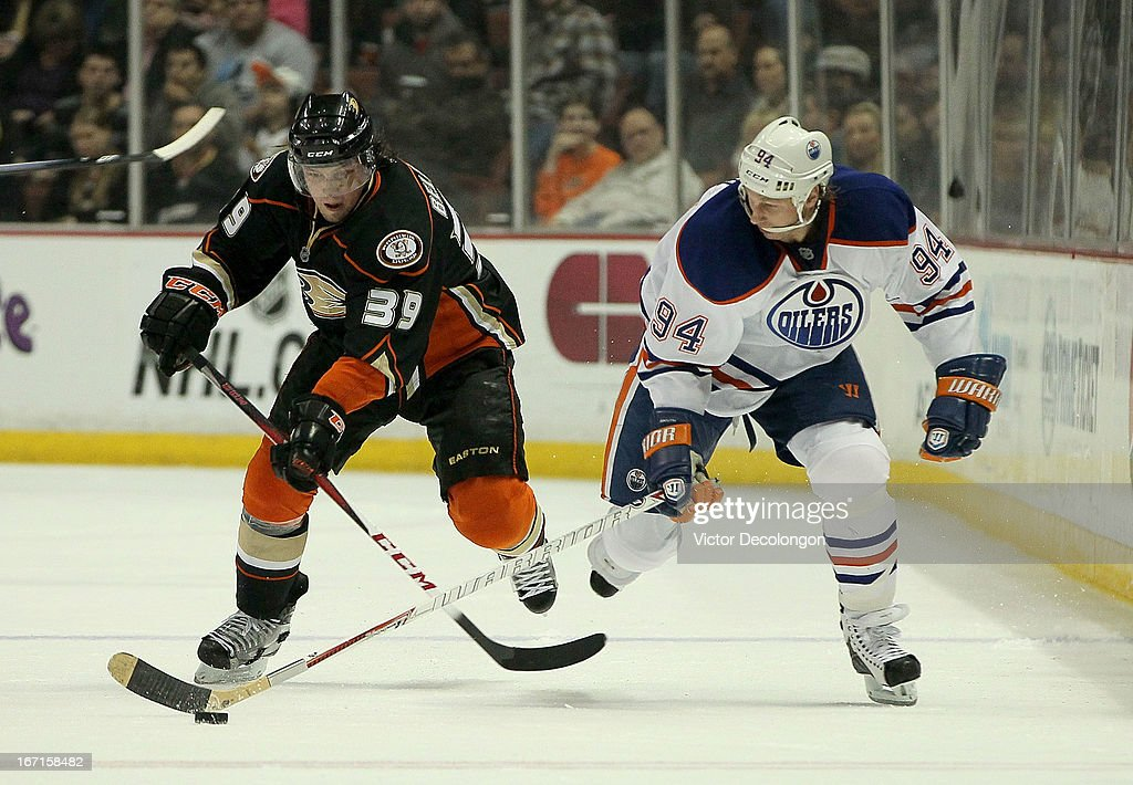 <a gi-track='captionPersonalityLinkClicked' href=/galleries/search?phrase=Matt+Beleskey&family=editorial&specificpeople=570471 ng-click='$event.stopPropagation()'>Matt Beleskey</a> #39 of the Anaheim Ducks skates in pursuit of <a gi-track='captionPersonalityLinkClicked' href=/galleries/search?phrase=Ryan+Smyth+-+Ice+Hockey+Player&family=editorial&specificpeople=202567 ng-click='$event.stopPropagation()'>Ryan Smyth</a> #94 of the Edmonton Oilers in the second period during the NHL game at Honda Center on April 8, 2013 in Anaheim, California. The Ducks defeated the Oilers 2-1.