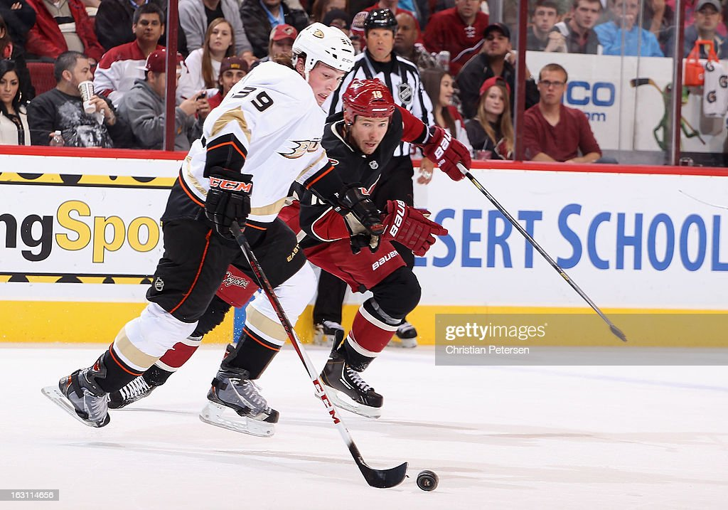<a gi-track='captionPersonalityLinkClicked' href=/galleries/search?phrase=Matt+Beleskey&family=editorial&specificpeople=570471 ng-click='$event.stopPropagation()'>Matt Beleskey</a> #39 of the Anaheim Ducks skates with the puck past David Moss #18 of the Phoenix Coyotes during the first period of the NHL game at Jobing.com Arena on March 4, 2013 in Glendale, Arizona. The Coyotes defeated the Ducks 5-4 in an overtime shootout.