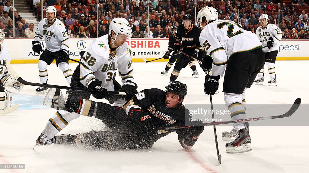 Matt Beleskey #39 of the Anaheim Ducks slides into Philip Larsen #36 of the Dallas Stars on April 3, 2013 at Honda Center in Anaheim, California.
