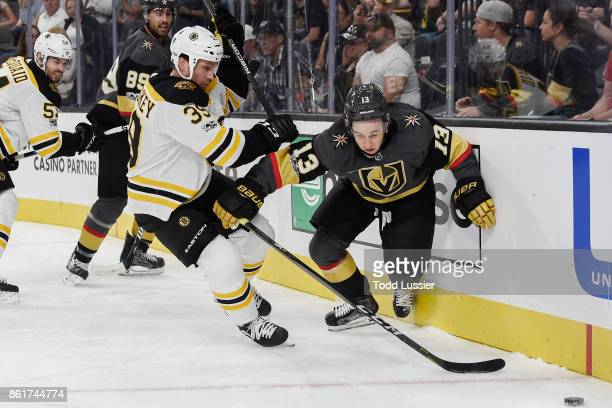 Matt Beleskey of the Boston Bruins and Brendan Leipsic of the Vegas Golden Knights battle for the puck near the boards during the game at TMobile...
