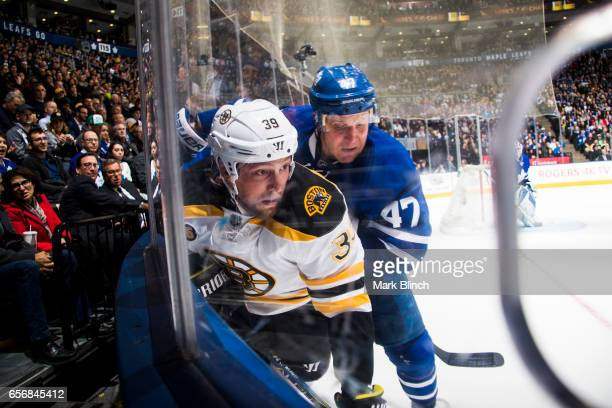 Matt Beleskey of the Boston Bruins battles with Leo Komarov of the Toronto Maple Leafs during the second period at the Air Canada Centre on March 20...