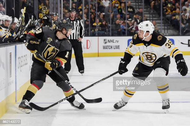 Matt Beleskey of the Boston Bruins defends Brendan Leipsic of the Vegas Golden Knights during the game at TMobile Arena on October 15 2017 in Las...