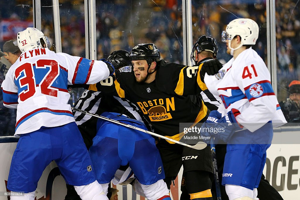 <a gi-track='captionPersonalityLinkClicked' href=/galleries/search?phrase=Matt+Beleskey&family=editorial&specificpeople=570471 ng-click='$event.stopPropagation()'>Matt Beleskey</a> #39 of the Boston Bruins holds back <a gi-track='captionPersonalityLinkClicked' href=/galleries/search?phrase=Brian+Flynn+-+Ice+Hockey+Player&family=editorial&specificpeople=10837297 ng-click='$event.stopPropagation()'>Brian Flynn</a> #32 and <a gi-track='captionPersonalityLinkClicked' href=/galleries/search?phrase=Paul+Byron+-+Ice+Hockey+Player&family=editorial&specificpeople=4535697 ng-click='$event.stopPropagation()'>Paul Byron</a> #41 of the Montreal Canadiens late in the third period during the 2016 Bridgestone NHL Winter Classic at Gillette Stadium on January 1, 2016 in Foxboro, Massachusetts.