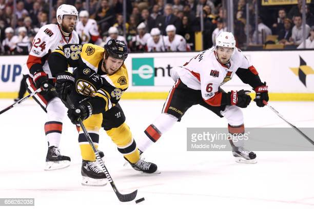 Matt Beleskey of the Boston Bruins skates against Chris Wideman of the Ottawa Senators during the first period at TD Garden on March 21 2017 in...