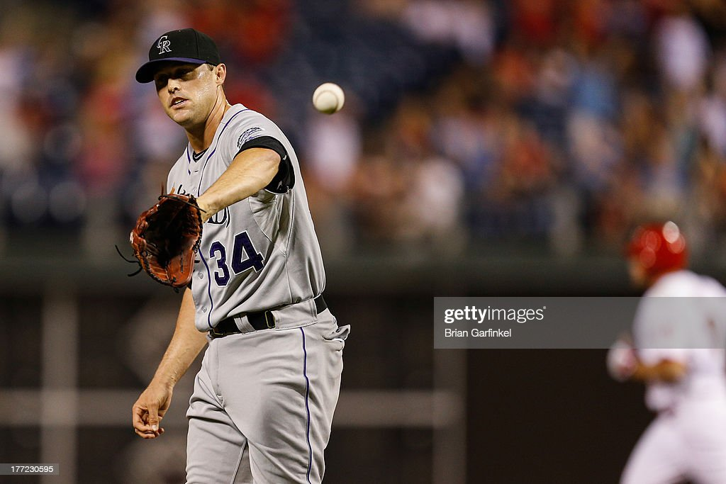 <a gi-track='captionPersonalityLinkClicked' href=/galleries/search?phrase=Matt+Belisle&family=editorial&specificpeople=666580 ng-click='$event.stopPropagation()'>Matt Belisle</a> #34 of the Colorado Rockies catches the ball after giving up a two run home run in the eighth inning of the game against the Colorado Rockies at Citizens Bank Park on August 22, 2013 in Philadelphia, Pennsylvania. The Phillies won 5-4.