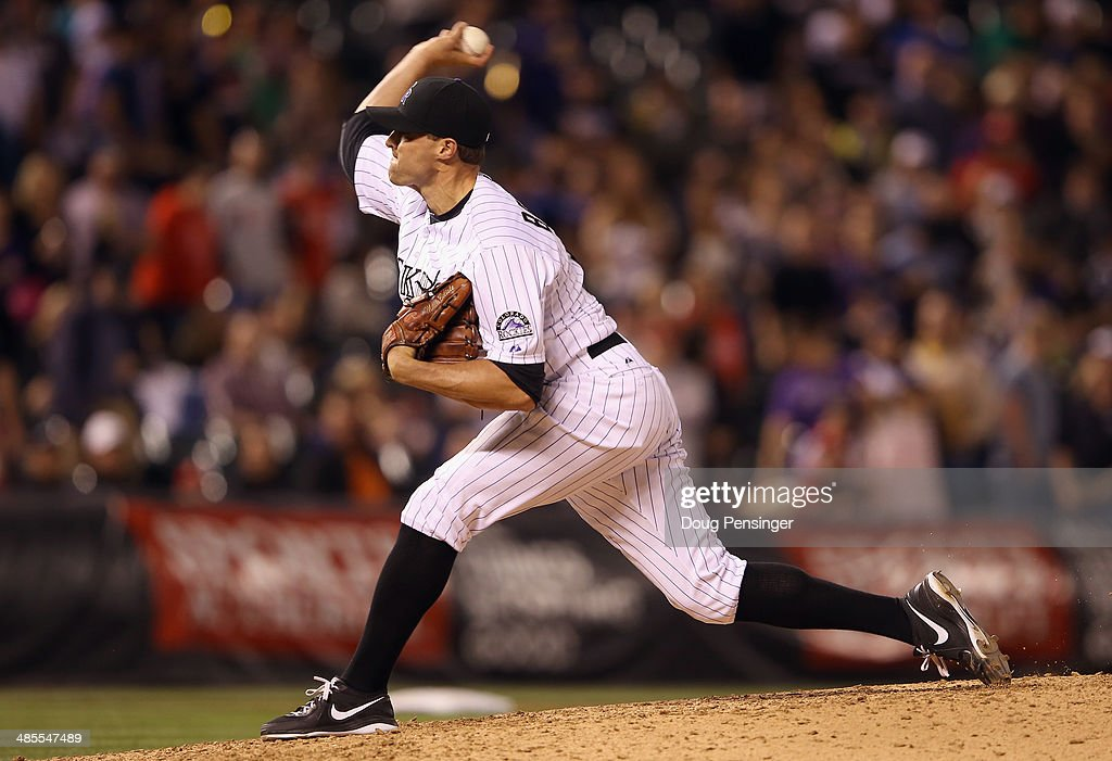 <a gi-track='captionPersonalityLinkClicked' href=/galleries/search?phrase=Matt+Belisle&family=editorial&specificpeople=666580 ng-click='$event.stopPropagation()'>Matt Belisle</a> #34 of the Colorado Rockies delivers against the Philadelphia Phillies in the ninth inning at Coors Field on April 18, 2014 in Denver, Colorado. The Rockies defeated the Phillies 12-1.