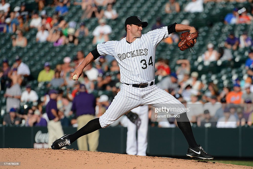 <a gi-track='captionPersonalityLinkClicked' href=/galleries/search?phrase=Matt+Belisle&family=editorial&specificpeople=666580 ng-click='$event.stopPropagation()'>Matt Belisle</a> #34 of the Colorado Rockies pitches during the game against the New York Mets at Coors Field on June 27, 2013 in Denver, Colorado. Photo by Garrett W. Ellwood/Getty Images)