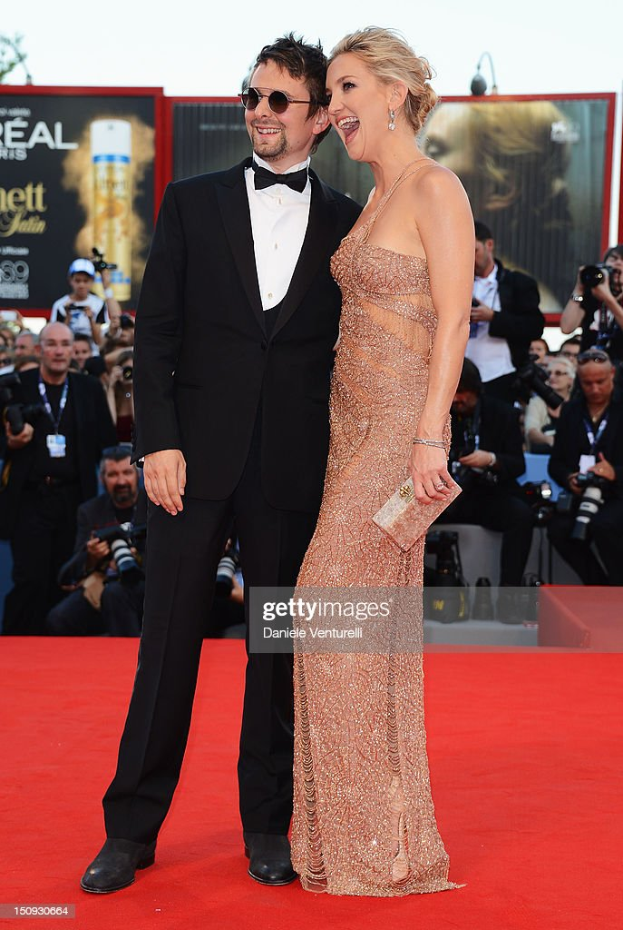 Matt Bellamy (L) and actress <a gi-track='captionPersonalityLinkClicked' href=/galleries/search?phrase=Kate+Hudson&family=editorial&specificpeople=156407 ng-click='$event.stopPropagation()'>Kate Hudson</a> attend The Reluctant Fundamentalist premiere and opening ceremony during the 69th Venice Film Festival at the Palazzo del Cinema on August 29, 2012 in Venice, Italy.