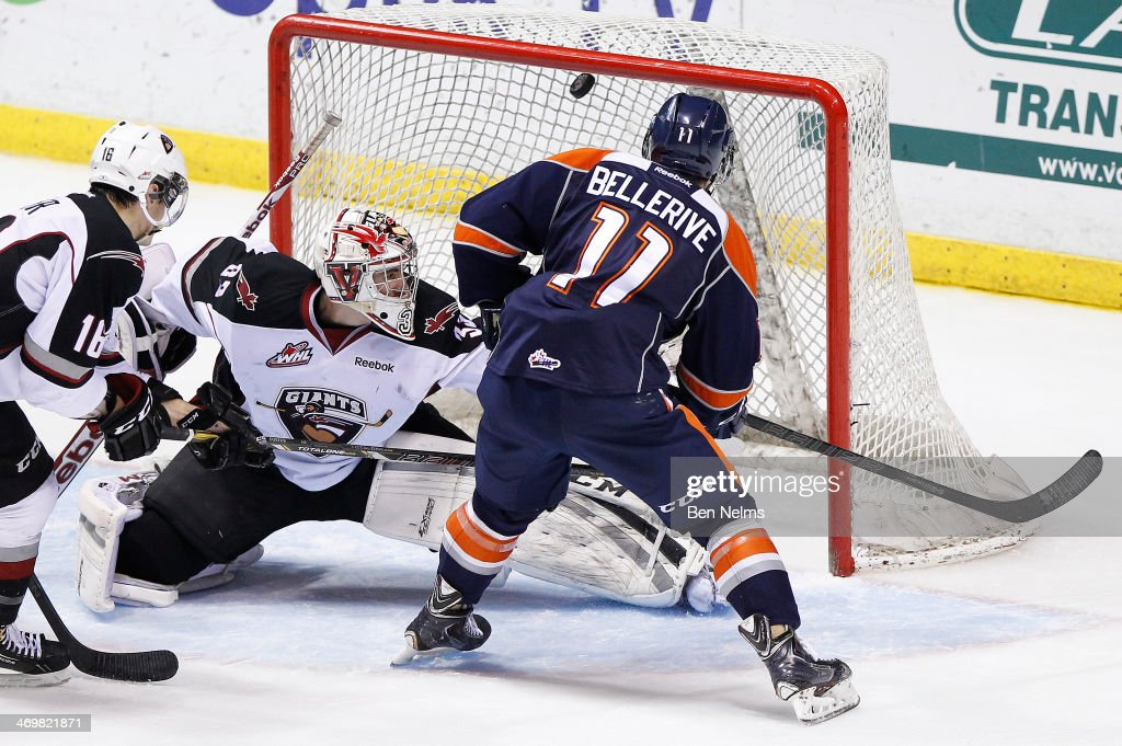 Matt Bellerive of the Kamloops Blazers scores against goaltender Jared Rathjen of the Vancouver Giants during the second period of their WHL game at...