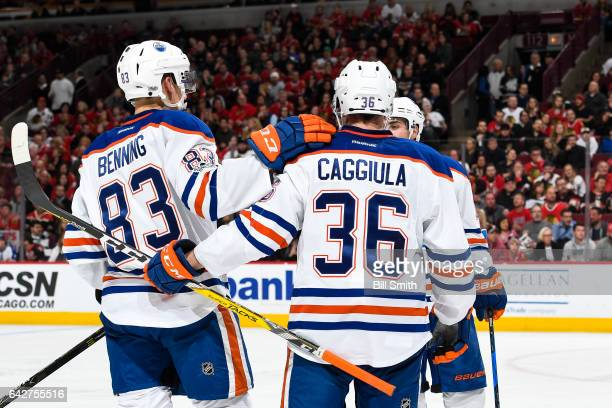 Matt Benning and Drake Caggiula of the Edmonton Oilers celebrate after Benning scored against the Chicago Blackhawks in the second period at the...