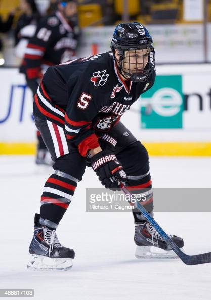 Matt Benning of the Northeastern University Huskies warms up before NCAA hockey action against the Harvard Crimson in the semifinals of the annual...