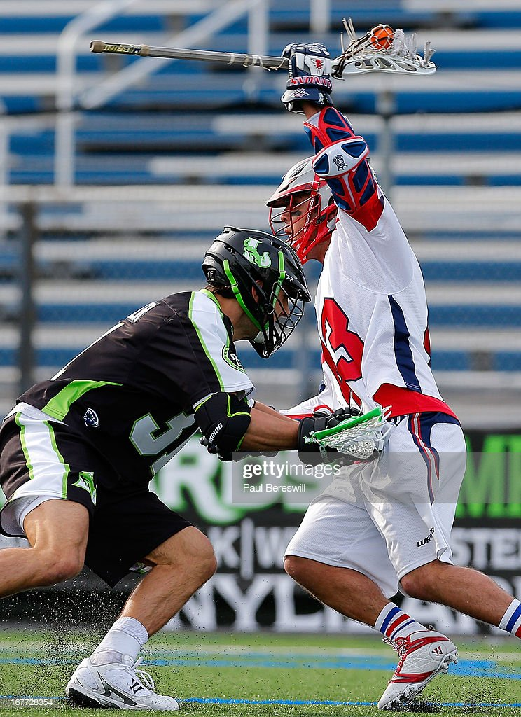 Matt Bernier #31 of the New York Lizzards checks Ari Sussman #43 of the Boston Cannons as Sussman breaks by in the first half of a Major League Lacrosse game at James M. Shuart Stadium on April 28, 2013 in Hempstead, New York.