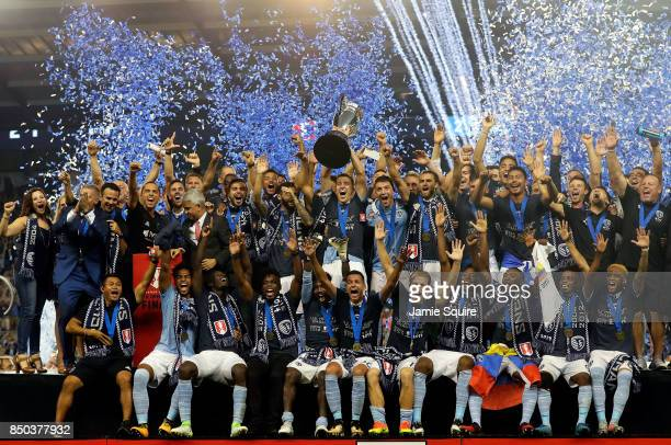 Matt Besler and Sporting Kansas City celebrate with the trophy after they defeated New York Red Bulls 21 to win the 2017 US Open Cup Final at...