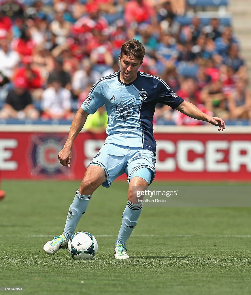 Matt Besler #5 of Sporting Kansas City passes against the Chicago Fire during an MLS match at Toyota Park on July 7, 2013 in Bridgeview, Illinois. Sporting Kansas City defeated the Fire 2-1.
