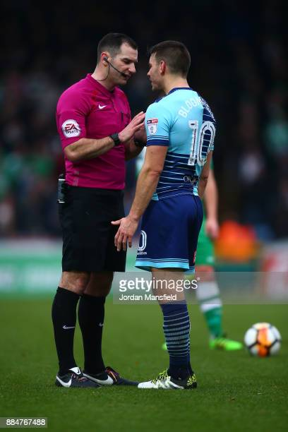 Matt Bloomfield of Wycombe Wanderers is shown a yellow card by referee Tim Robinson during The Emirates FA Cup Second Round between Wycombe Wanderers...
