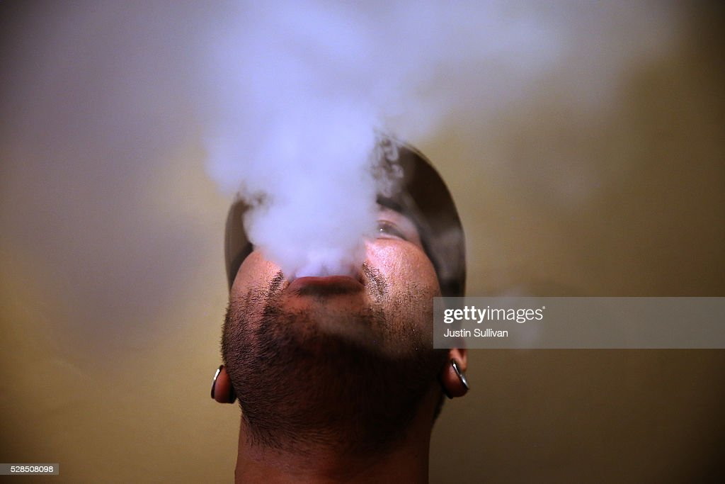 Matt blows vapor from an e-cigarette at Gone With the Smoke Vapor Lounge on May 5, 2016 in San Francisco, California. The U.S. Food and Drug Administration announced new federal regulations on electronic cigarettes that will be the same as traditional tobacco cigarettes and chewing tobacco.