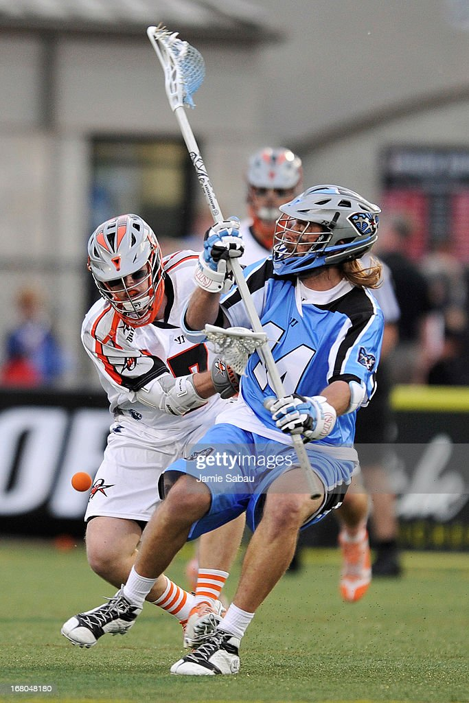Matt Bocklet #7 of the Denver Outlaws knocks the ball loose from Greg Bice #44 of the Ohio Machine in the first period on May 4, 2013 at Selby Stadium in Delaware, Ohio.