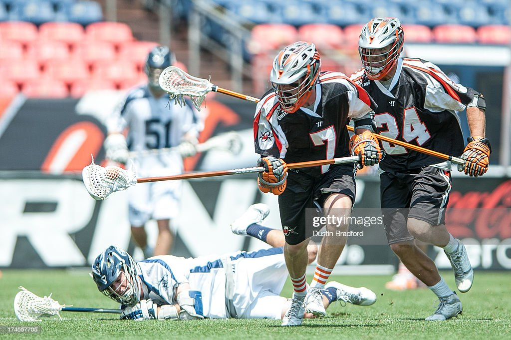 Matt Bocklet #7 of the Denver Outlaws picks up a loose ball against the Chesapeake Bayhawks during a Major League Lacrosse game at Sports Authority Field at Mile High on July 27, 2013 in Denver, Colorado. The Outlaws beat the Bayhawks 14-12.