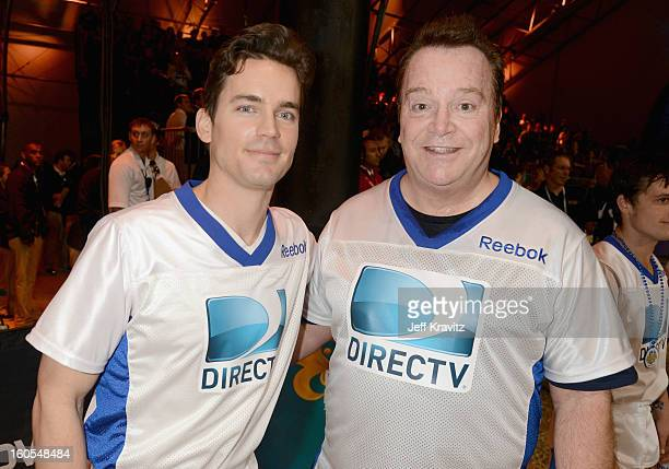 Matt Bomer and Tom Arnold attend DIRECTV'S 7th Annual Celebrity Beach Bowl at DTV SuperFan Stadium at Mardi Gras World on February 2 2013 in New...