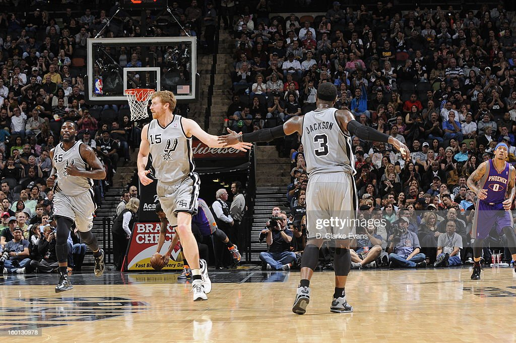 Matt Bonner #15 and Stephen Jackson #3 of the San Antonio Spurs high five during the game against the Phoenix Suns on January 26, 2013 at the AT&T Center in San Antonio, Texas.