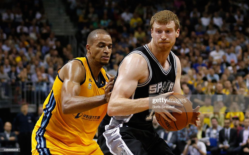 Matt Bonner (R)of San Antonio is challenged by Alex King of Berlin during the NBA Global Games Tour 2014 match between Alba Berlin and San Antonio Spurs at O2 World on October 8, 2014 in Berlin, Germany.