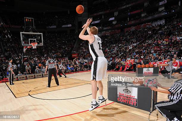 Matt Bonner of the San Antonio Spurs attempts a shot during the 2013 Foot Locker ThreePoint Contest on State Farm AllStar Saturday Night as part of...