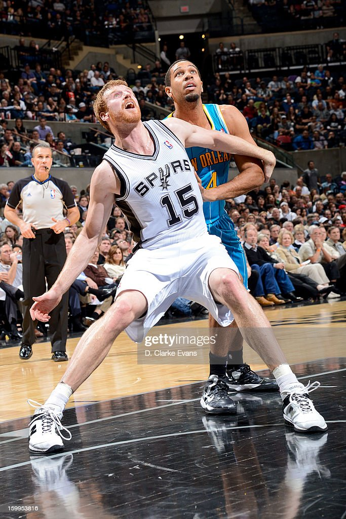 <a gi-track='captionPersonalityLinkClicked' href=/galleries/search?phrase=Matt+Bonner&family=editorial&specificpeople=203054 ng-click='$event.stopPropagation()'>Matt Bonner</a> #15 of the San Antonio Spurs battles for rebound position against <a gi-track='captionPersonalityLinkClicked' href=/galleries/search?phrase=Xavier+Henry&family=editorial&specificpeople=5792007 ng-click='$event.stopPropagation()'>Xavier Henry</a> #4 of the New Orleans Hornets on January 23, 2013 at the AT&T Center in San Antonio, Texas.