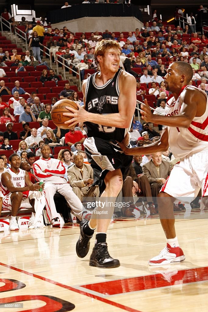 Matt Bonner #15 of the San Antonio Spurs drives to the basket against Rafer Alston #12 of the Houston Rockets during the game at the Toyota Center on October 9, 2008 in Houston, Texas. The Rockets won 85-78.