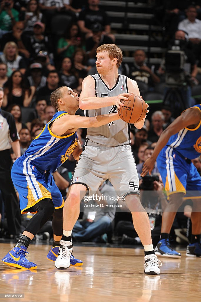 Matt Bonner #15 of the San Antonio Spurs handles the ball against Stephen Curry #30 of the Golden State Warriors in Game One of the Western Conference Semifinals during the 2013 NBA Playoffs on May 6, 2013 at the AT&T Center in San Antonio, Texas.