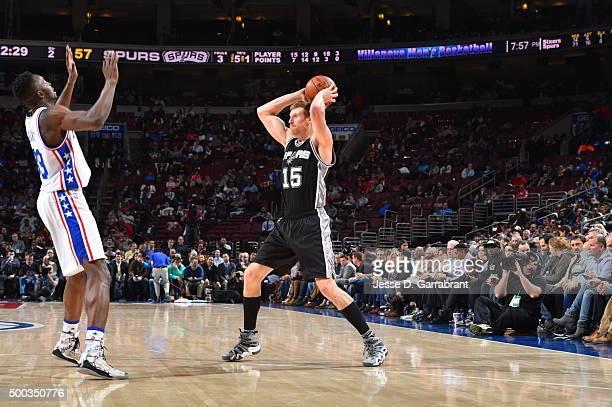 Matt Bonner of the San Antonio Spurs looks to pass the ball against the Philadelphia 76ers at Wells Fargo Center on December 7 2015 in Philadelphia...
