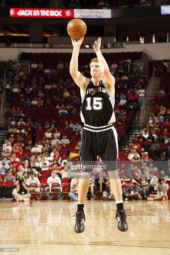 Matt Bonner #15 of the San Antonio Spurs shoots a jump shot during the game against the Houston Rockets at the Toyota Center on October 9, 2008 in Houston, Texas. The Rockets won 85-78.