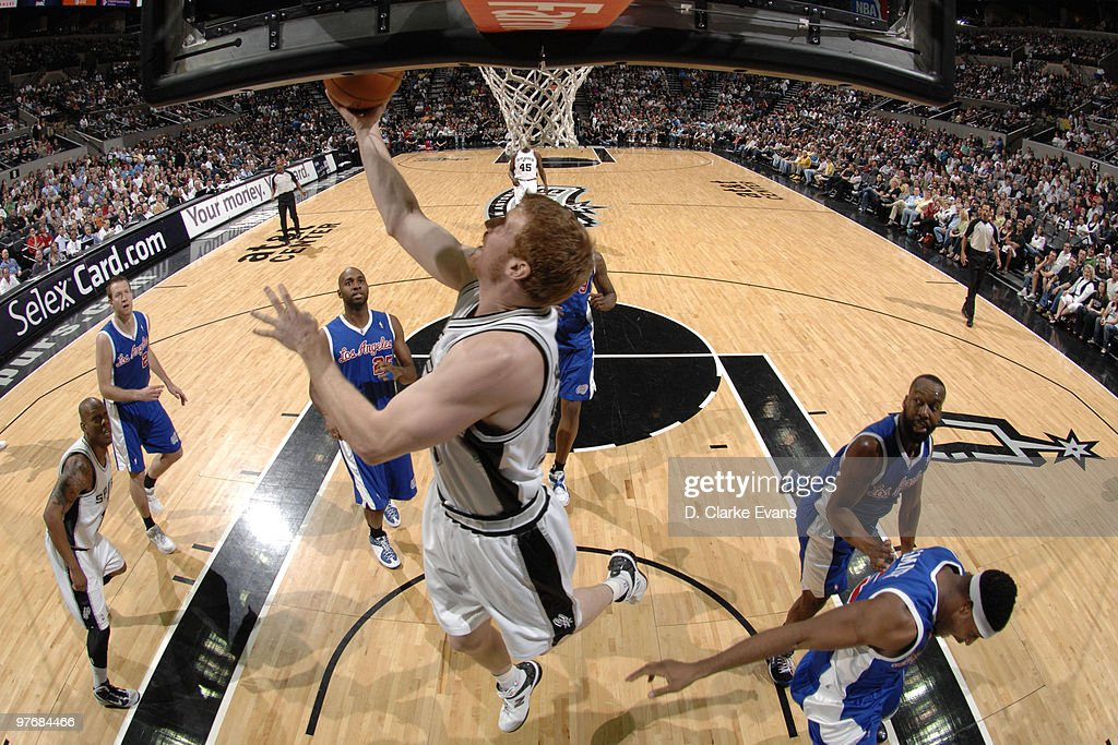 Matt Bonner #15 of the San Antonio Spurs shoots a reverse layup against the Los Angeles Clippers on March 13, 2010 at the AT&T Center in San Antonio, Texas.