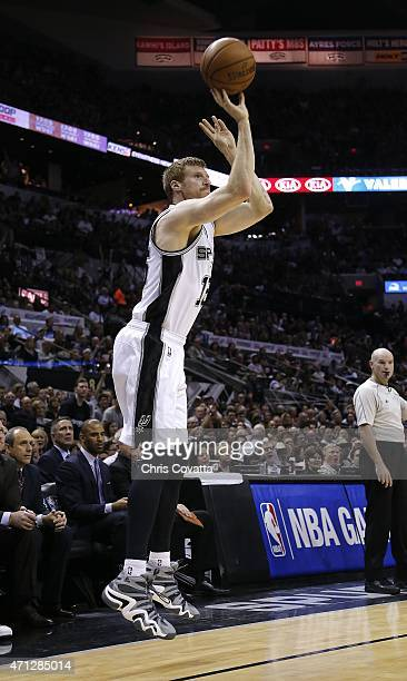 Matt Bonner of the San Antonio Spurs shoots a three point shot against the Los Angeles Clippers during Game Three of the Western Conference...