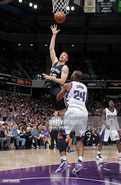 Matt Bonner of the San Antonio Spurs shoots against Carl Landry of the Sacramento Kings on November 15 2014 at Sleep Train Arena in Sacramento...