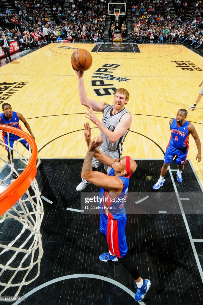 Matt Bonner #15 of the San Antonio Spurs shoots in the lane against Charlie Villanueva #31 of the Detroit Pistons on March 3, 2013 at the AT&T Center in San Antonio, Texas.