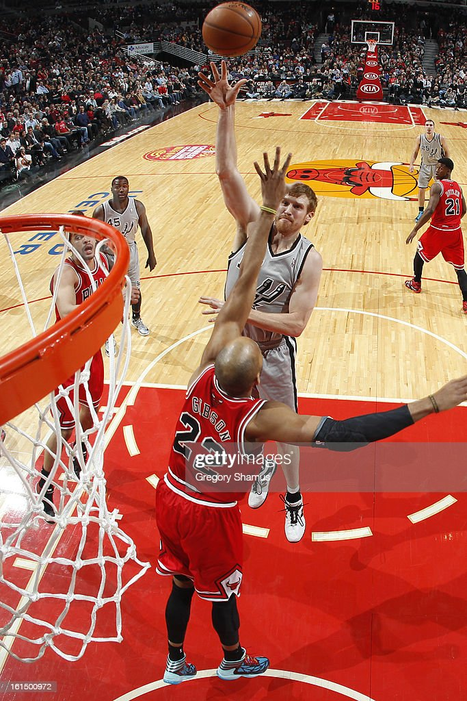 Matt Bonner #15 of the San Antonio Spurs shoots in the lane against Taj Gibson #22 of the Chicago Bulls on February 11, 2013 at the United Center in Chicago, Illinois.